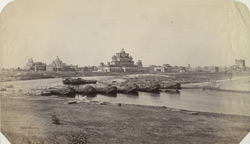 Lucknow. Chutter Munzil from the Moti Mahal [with a bridge of boats in the foreground].